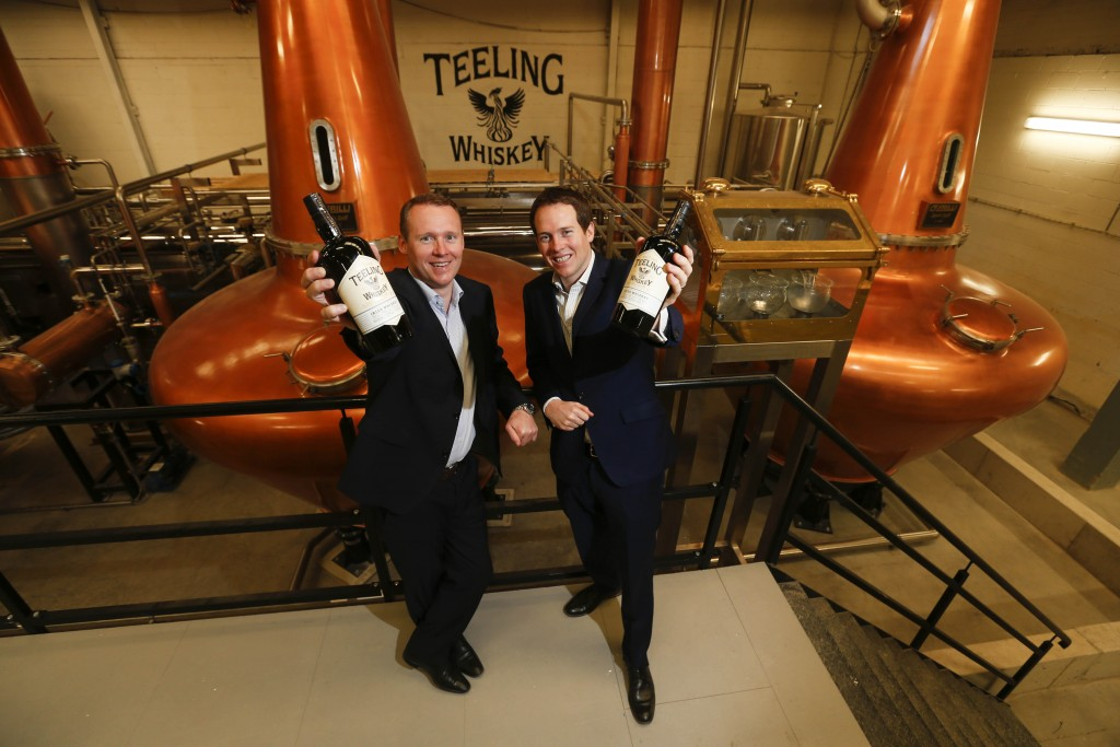 *** NO REPRODUCTION FEE *** DUBLIN : 9/06/2015 : Pictured are brothers Jack and Stephen Teeling at the official opening of the new Teeling Whiskey Distillery and visitor centre in The Liberties, Dublin 8. The €10 million distillery is the first new distillery in Dublin in over 125 years and the only fully operational distillery in the city. As well the distillery, there is a state-of-the-art visitor centre, which will host whiskey tasting tours, a café, a bar, a private event space for hire and a gift shop. Founded by Jack Teeling in 2012, the Teeling Whiskey Company (TWC) was set up to revive his family-old trademark of Irish whiskey and bring distilling back to Dublin. TWC is run by Jack together with his brother Stephen and the opening of this new distillery means that they have complete control of all aspects of their whiskey production, from grain to bottle. The distillery will be open to the public from Saturday, June 13th, 9.30am - 5.30pm. For more, visit www.TeelingWhiskey.com Picture Conor McCabe Photography. MEDIA CONTACT : Sarah Doyle, notorious PSG E: sarah.doyle@notoriouspsg.ie M:+353 879530551